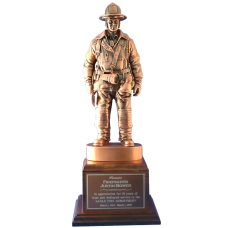 Coppertone Firefighter Statue